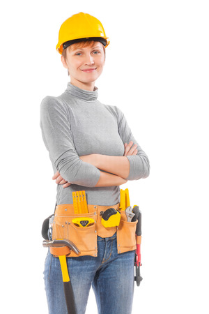 portrait of a female worker with tools isolated on white background photo