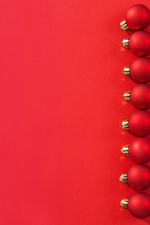 smal: copyspace image row of smal red christmas baubles