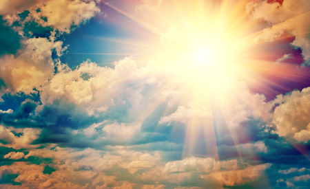 spirituality: view on beautiful sun in blue cloudy sky instagram stile instagr Stock Photo