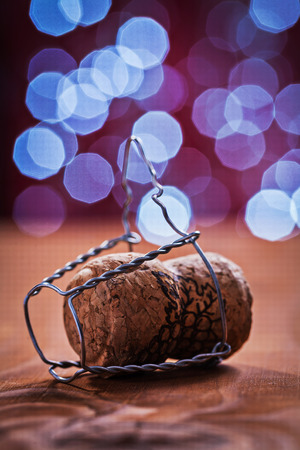 champagne cork: champagne cork with wire on old wooden table Stock Photo