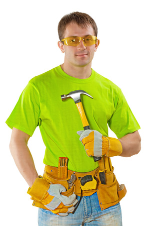 young construction worker with tools holding claw hammer and looking at camera isolated on white background photo