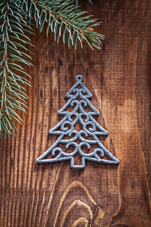 chrstmas: chrstmas toys fir tree with branches of firtree  on old wooden board close up