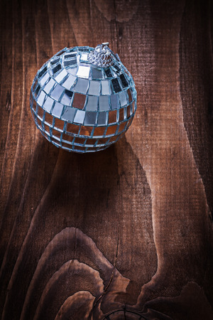 hanging toy: single christmas hanging toy mirror disco ball on old wooden board