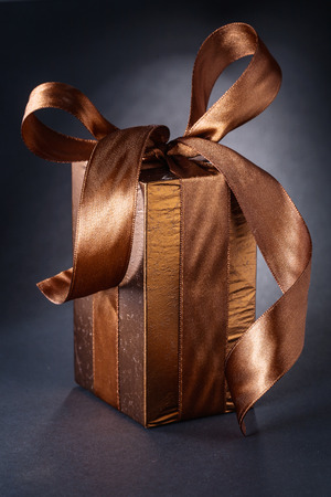 classical giftbox with bow on black background photo