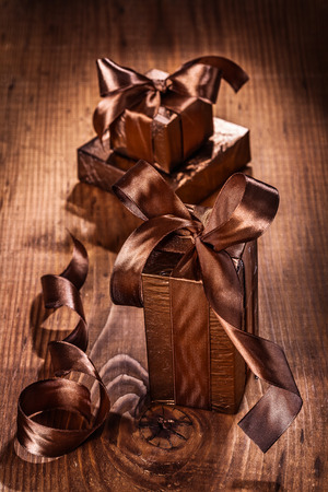 set of giftboxes on old wooden board photo