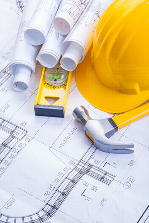 claw hammer: claw hammer construction level helmet rolled blueprints Stock Photo