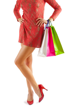paperbags: concept view on female body with paperbags in hand isolated white Stock Photo