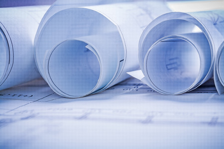new beginning: rolls of blueprints very close up horizontal view