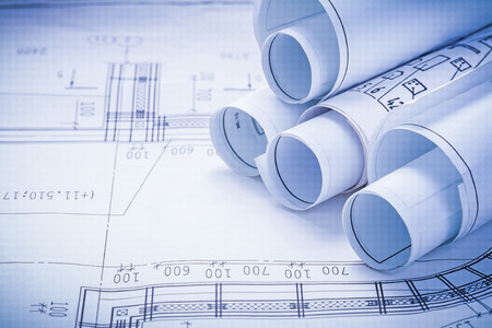 engineering plans: close up view stack of white construction blueprints with copysp Stock Photo