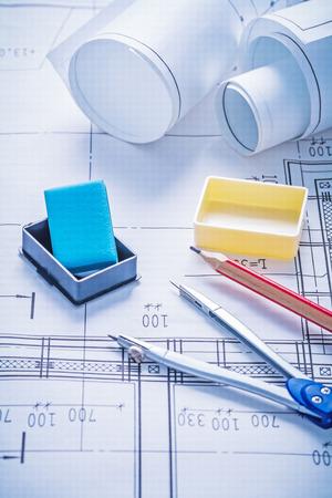 comp: construction concept composition rolls of blueprints eraser comp