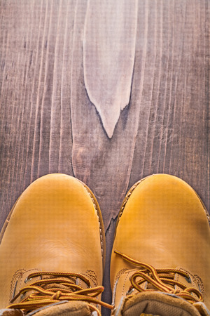 steel toe boots: close up view on working boots vintage wooden board with copyspa