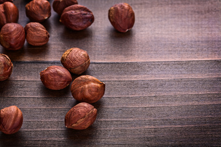 kernels of hazelnut on vintage wooden board horizontal version f photo