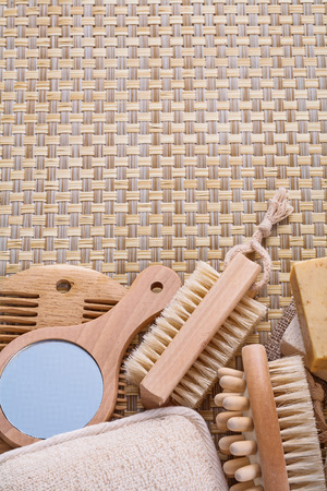 nail brush: mirror hairbrush nail brush massager soap on wicker background w Stock Photo