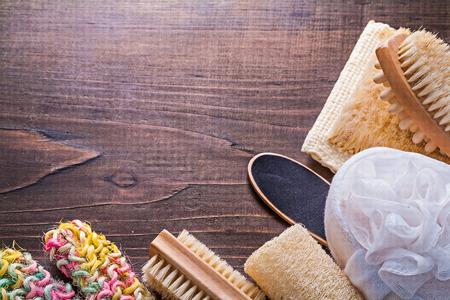 wisps: set of bath accessories wisps massager brush on vintage wooden b Stock Photo