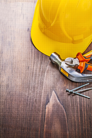 construction nails: copyspace image claw hammer nippers nails yellow helmet on vinta