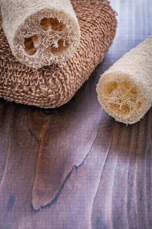 bast: two loofahs and brown batch bast on vintage wooden board Stock Photo