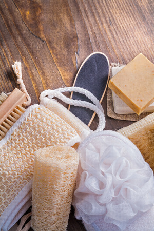 wisps soap brush loofah on vintage wooden board photo