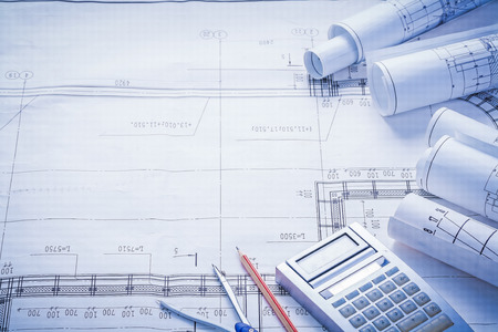 business focus: compass pencil calculator rolled blueprints with big place for t Stock Photo