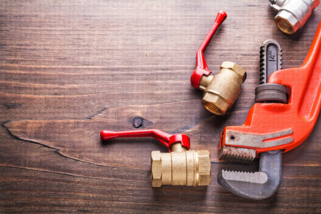 fixtures: organized copyspace plumbers fixtures monkey wrench on vintage w