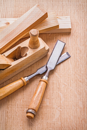 compostion: compostion of woodworkers plane and carpentry chisel wooden plan