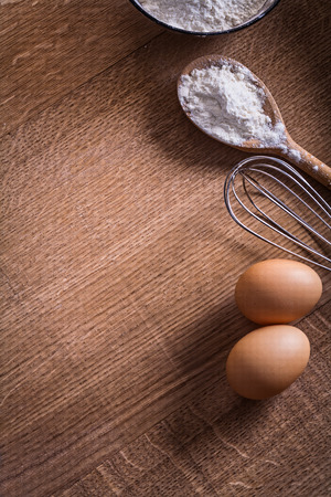 copysapce: copyspace image eggs corolla spoon with flour on vintage wooden