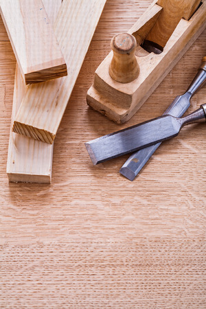chisels: carpentry chisels woodworkers plane and planks on wooden board