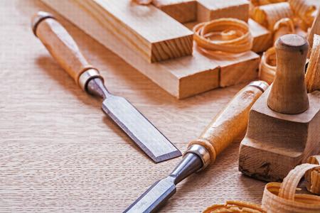 chisels: chisels plane planks shavings on wooden board