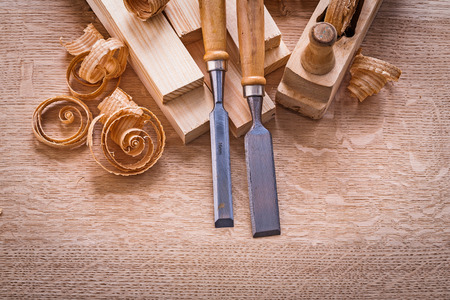 chisels: chisels shavings planks woodworkers plane on wooden board Stock Photo