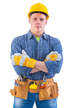 construction work: portrait of young men wearing working clothes with tools isolate