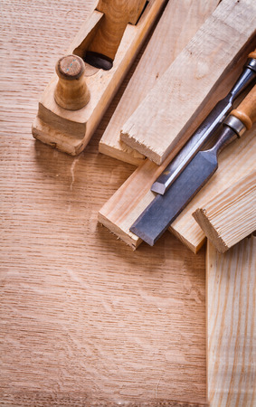 chisels: woodworkers plane planks and carpentry chisels on wooden board
