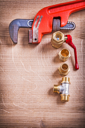 household fixture: Aerial View Organized Monkey Wrench And Brass Pipe