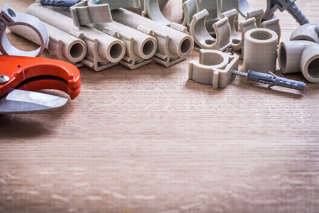 household fixture: Big Set Polypropylene Fixators And Pipes With Clips Pipe Cutter Stock Photo