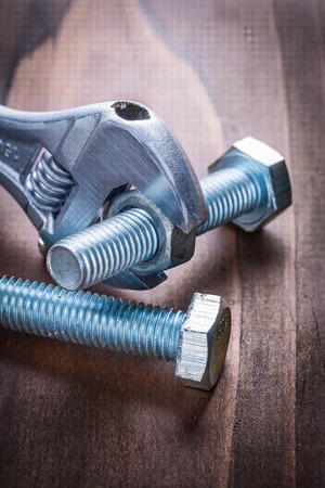 close up  wrench: close up view on nut and bolts with adjustable wrench Stock Photo