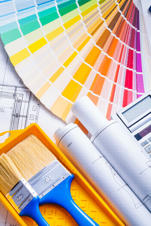composition of painting tools, paint brushes, blueprints and color palette