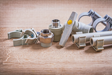 household fixture: Connectors Water Valve Polypropylene Fixators And  Pipe Stock Photo