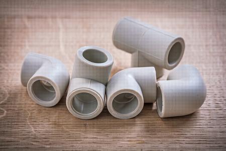 fittings: Polypropylene Pipe Fittings On Wooden Board