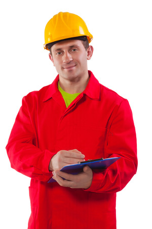smiling young worker wearing working clothes holding clipboard photo