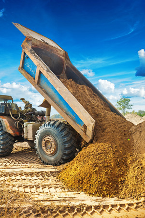 dump truck: tipper unloadding sand from scoop