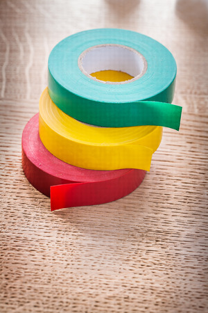 cordon tape: green red yellow rolls of insulating tape construction concept