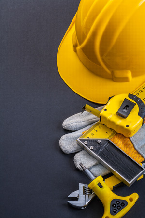 square ruler: helmet square ruler tapeline screwdriver wrench working glove on