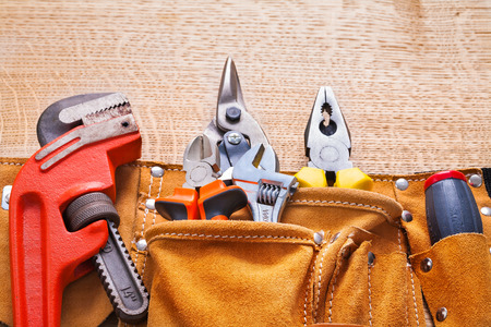 toolbelt: horizontal view construction tools in toolbelt monkey wrench nip