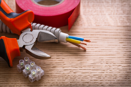 wirecutters: nippers insulating tape and terminal blocks for electric cables Stock Photo