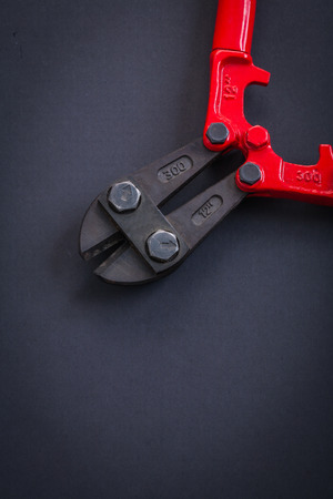wirecutters: opened vertical version streel cutter very close up aerial view Stock Photo