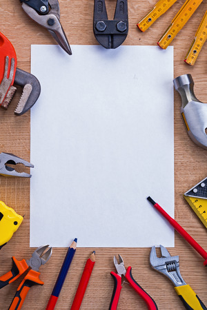 wirecutters: organized copyspace white shhet of paper and cutter meter hammer Stock Photo