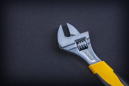 close up  wrench: adjustable wrench close up on black background Stock Photo