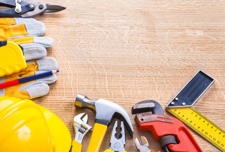 wirecutters: organized copyspace ruler wrench nippers pliers hammer helmet gl Stock Photo