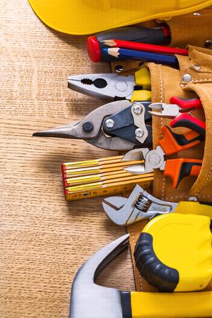 duty belt: hammer tape measure wrench nippers pliers cutter pencil in toolb