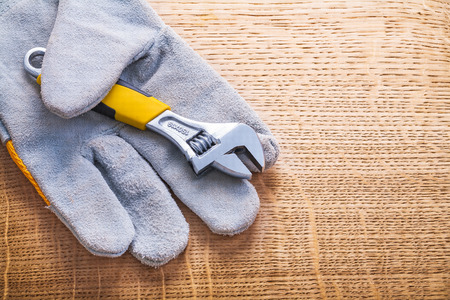 protective work wear: horizontal version adjustabe wrench and protective working glove Stock Photo
