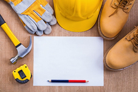 tapeline: pencil and paper tapeline hammer working boots helmet gloves on Stock Photo