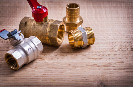 household fixture: View Plumbing Tools Brass Pipe Connectors On Wooden Board Close